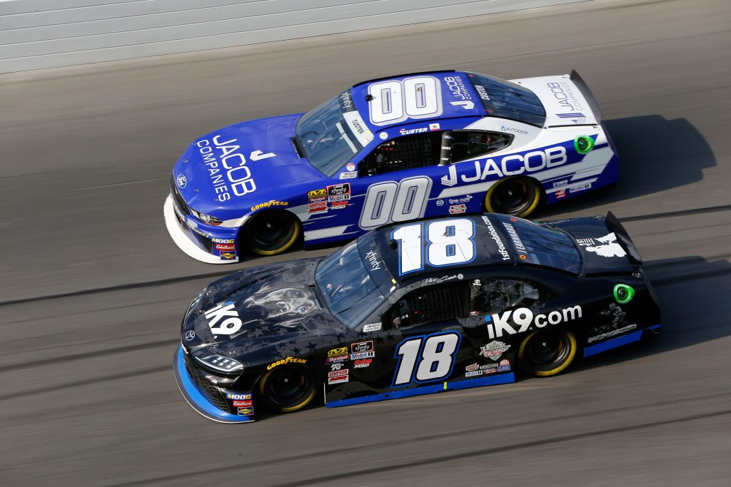 DAYTONA BEACH, FL - FEBRUARY 16: Jeffrey Earnhardt, driver of the #18 iK9 Toyota, drives next to Cole Custer, driver of the #00 Jacob Companies Ford, during the NASCAR Xfinity Series NASCAR Racing Experience 300 at Daytona International Speedway on February 16, 2019 in Daytona Beach, Florida. (Photo by Jonathan Ferrey/Getty Images) | Getty Images