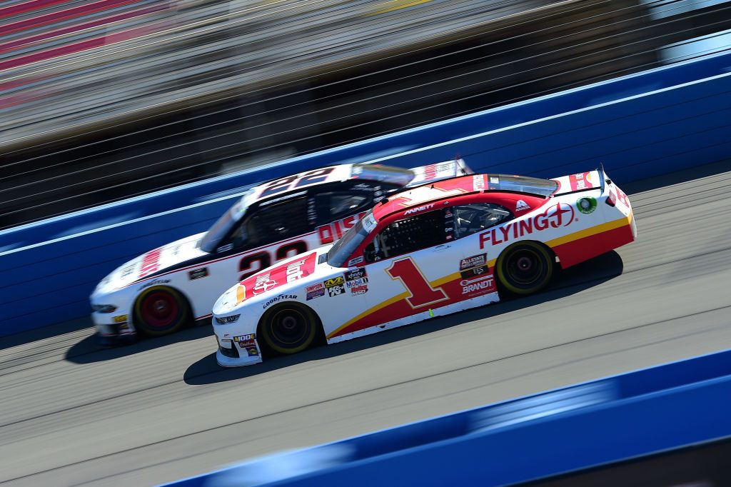 FONTANA, CA - MARCH 16: Michael Annett, driver of the #1 Pilot/Flying J Chevrolet, races Austin Cindric, driver of the #22 America's Tire/Discount Tire Ford, during the NASCAR Xfinity Series Production Alliance Group 300 at Auto Club Speedway on March 16, 2019 in Fontana, California. (Photo by Jared C. Tilton/Getty Images)   Getty Images