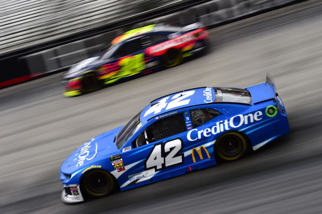 BRISTOL, TN - APRIL 07: Kyle Larson, driver of the #42 Credit One Bank Chevrolet, races William Byron, driver of the #24 Axalta Chevrolet, during the Monster Energy NASCAR Cup Series Food City 500 at Bristol Motor Speedway on April 7, 2019 in Bristol, Tennessee. (Photo by Jared C. Tilton/Getty Images) | Getty Images
