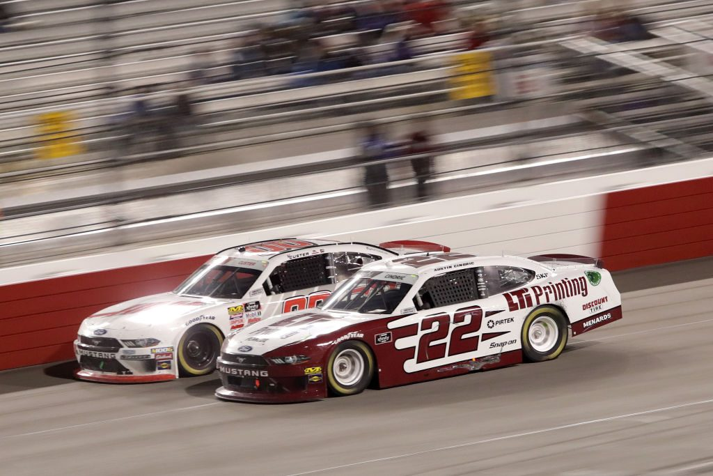 RICHMOND, VA - APRIL 12: Cole Custer, driver of the #00 Haas Automation Ford, leads Austin Cindric, driver of the #22 LTi Printing Ford, during the NASCAR Xfinity Series ToyotaCare 250 at Richmond Raceway on April 12, 2019 in Richmond, Virginia. (Photo by Donald Page/Getty Images) | Getty Images