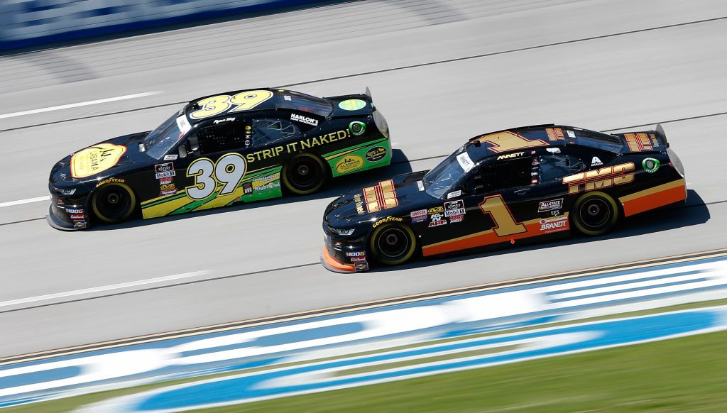 TALLADEGA, AL - APRIL 27: Ryan Sieg, driver of the #39 Larry's Hard Lemonade Chevrolet, races, Michael Annett, driver of the #1 TMC Transportation Chevrolet, during the NASCAR Xfinity Series MoneyLion 300 at Talladega Superspeedway on April 27, 2019 in Talladega, Alabama. (Photo by Brian Lawdermilk/Getty Images)   Getty Images