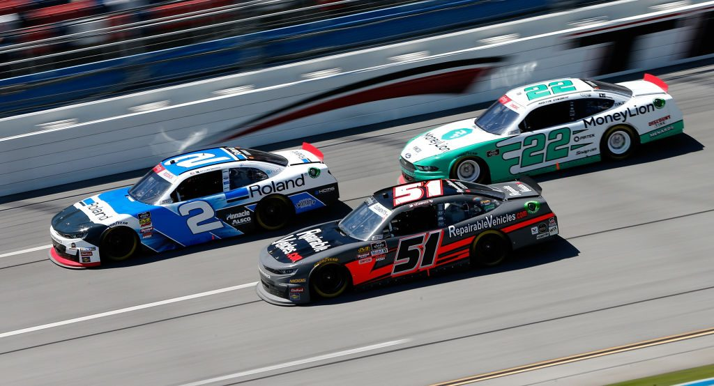TALLADEGA, AL - APRIL 27: Tyler Reddick, driver of the #2 Roland Chevrolet, leads, Jeremy Clements, driver of the #51 RepairableVehicles.com Chevrolet, and Austin Cindric, driver of the #22 MoneyLion Ford, during the NASCAR Xfinity Series MoneyLion 300 at Talladega Superspeedway on April 27, 2019 in Talladega, Alabama. (Photo by Brian Lawdermilk/Getty Images) | Getty Images