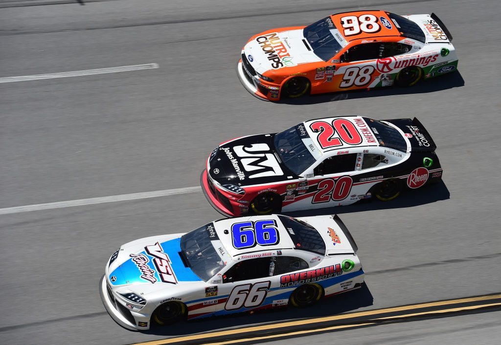 TALLADEGA, AL - APRIL 27: Timmy Hill, driver of the #66 VSI Racing/Overkill Motorsports Toyota, Christopher Bell, driver of the #20 Rheem/Johns Manville Toyota, and Chase Briscoe, driver of the #98 Nutri Chomps/Runnings Ford, race during the NASCAR Xfinity Series MoneyLion 300 at Talladega Superspeedway on April 27, 2019 in Talladega, Alabama. (Photo by Jared C. Tilton/Getty Images) | Getty Images