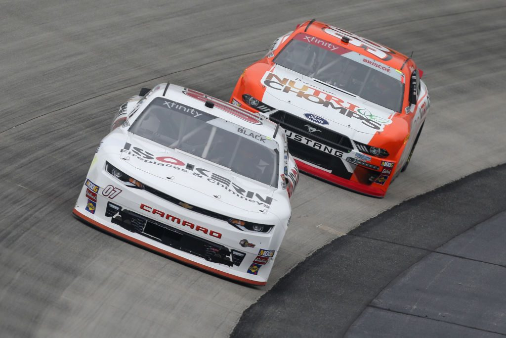 DOVER, DE - MAY 03:  Ray Black II, driver of the #07 ISOKERNFireplaces&, and Chase Briscoe, driver of the #98 Nutri Chomps Ford, drive during practice for the NASCAR Xfinity Series Allied Steel Buildings 200 at Dover International Speedway on May 3, 2019 in Dover, Delaware.  (Photo by Matt Sullivan/Getty Images) | Getty Images