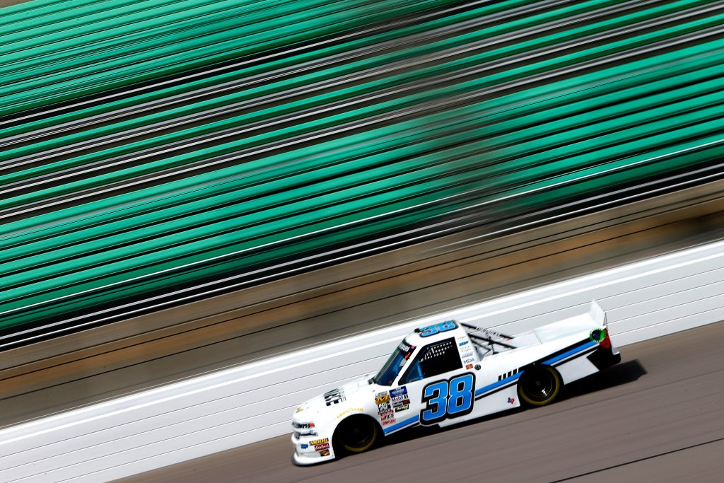 KANSAS CITY, KS - MAY 10: TJ Bell Jr., driver of the #38 Niece Equipment Chevrolet, drives during practice for the NASCAR Gander Outdoors Truck Series Digital Ally 250 at Kansas Speedway on May 10, 2019 in Kansas City, Kansas. (Photo by Jonathan Ferrey/Getty Images) | Getty Images