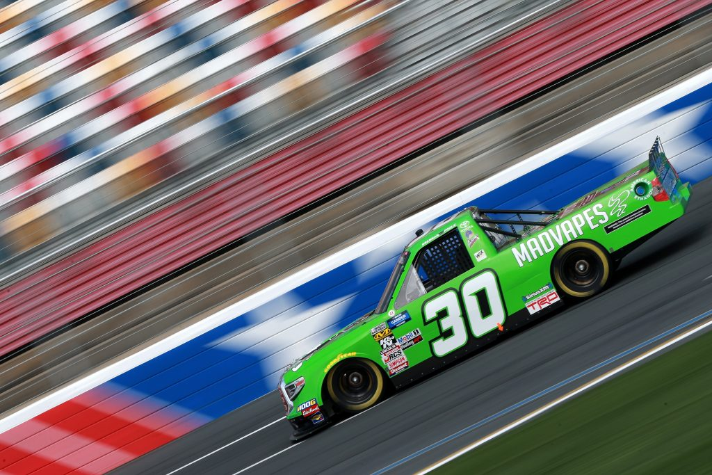 CHARLOTTE, NC - MAY 17: Brennan Poole, driver of the #30 Madvapes Toyota, practices for the NASCAR Gander Outdoors Truck Series North Carolina Education Lottery 200 at Charlotte Motor Speedway on May 17, 2019 in Charlotte, North Carolina. (Photo by Sean Gardner/Getty Images) | Getty Images