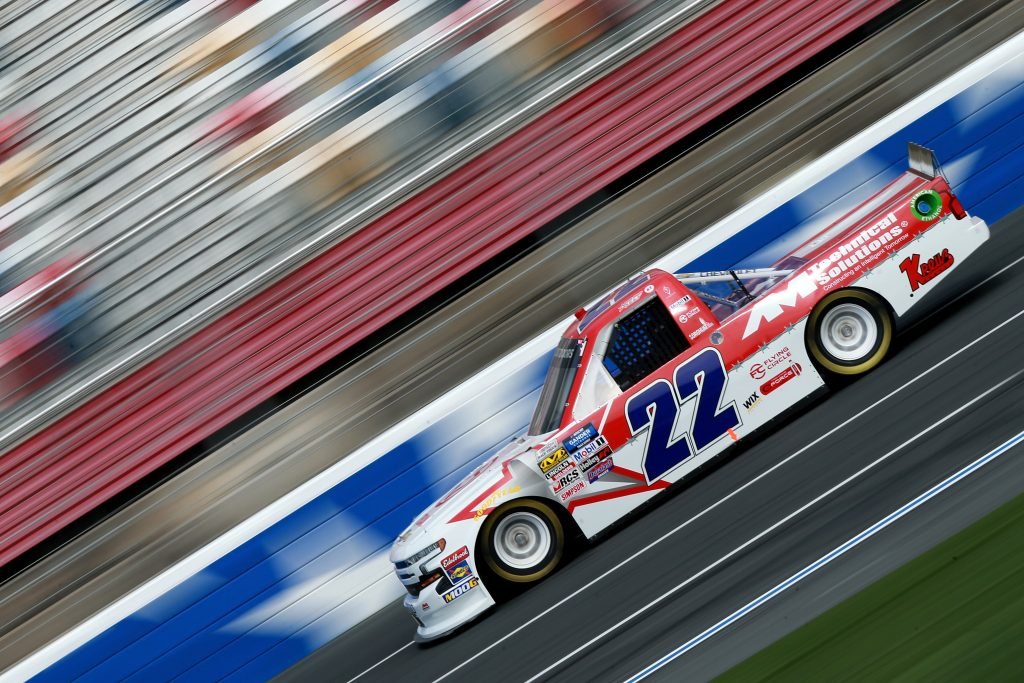CHARLOTTE, NC - MAY 17: Austin Wayne Self, driver of the #22 GO TEXAN/AM Technical Solutions Chevrolet, practices for the NASCAR Gander Outdoors Truck Series North Carolina Education Lottery 200 at Charlotte Motor Speedway on May 17, 2019 in Charlotte, North Carolina. (Photo by Sean Gardner/Getty Images) | Getty Images