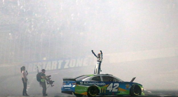 CHARLOTTE, NORTH CAROLINA - MAY 18: Kyle Larson, driver of the #42 Advent Health Chevrolet, celebrates winning the Monster Energy NASCAR Cup Series All-Star Race at Charlotte Motor Speedway on May 18, 2019 in Charlotte, North Carolina. (Photo by Sean Gardner/Getty Images) | Getty Images