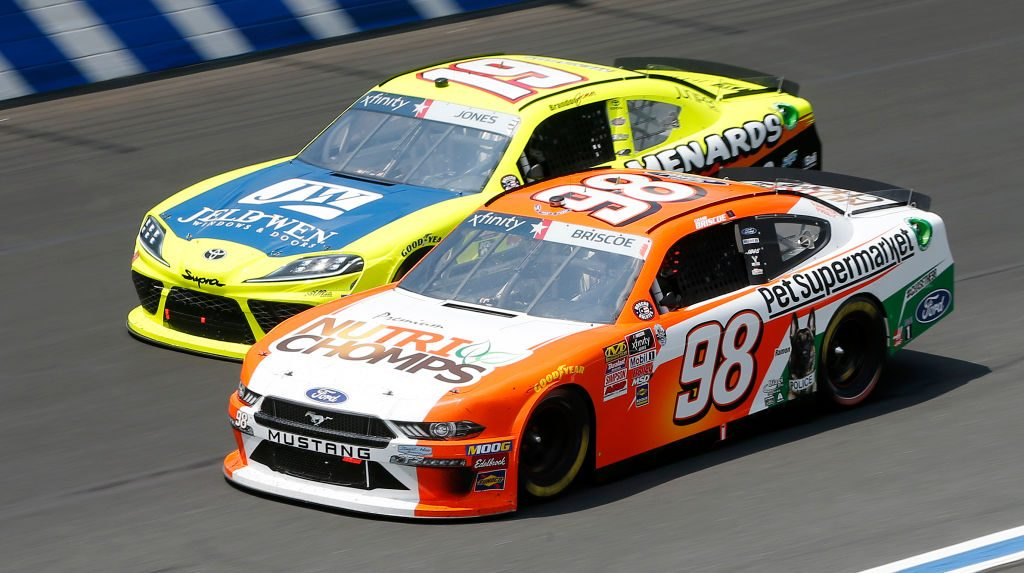 CHARLOTTE, NORTH CAROLINA - MAY 25: Chase Briscoe, driver of the #98 Nutri Chomps/Pet Supermarket Ford, and, Brandon Jones, driver of the #19 Menards/Jeld-Wen Toyota, race during the NASCAR Xfinity Series Alsco 300 at Charlotte Motor Speedway on May 25, 2019 in Charlotte, North Carolina. (Photo by Brian Lawdermilk/Getty Images) | Getty Images