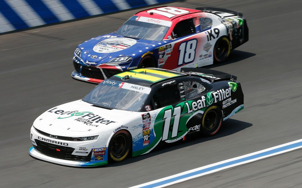 CHARLOTTE, NORTH CAROLINA - MAY 25: Justin Haley, driver of the #11 LeafFilter Gutter Protection Chevrolet, races, Jeffrey Earnhardt, driver of the #18 iK9 Toyota, during the NASCAR Xfinity Series Alsco 300 at Charlotte Motor Speedway on May 25, 2019 in Charlotte, North Carolina. (Photo by Brian Lawdermilk/Getty Images) | Getty Images