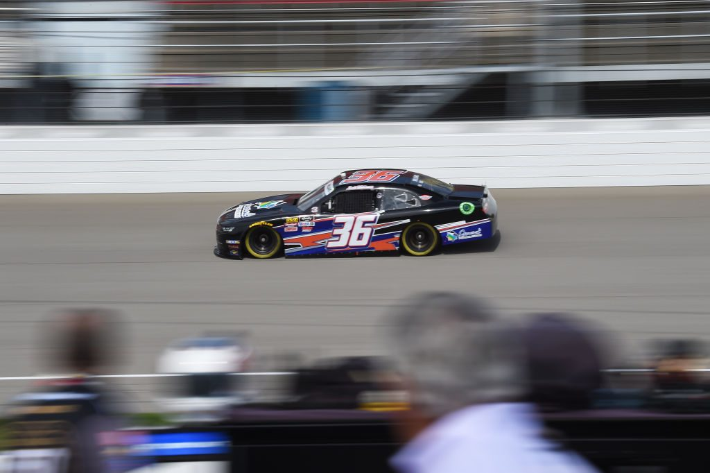 BROOKLYN, MICHIGAN - JUNE 08: Josh Williams, driver of the #36 Starbrite Star Tron/Simcraft Chevrolet, races during qualifying for the NASCAR Xfinity Series LTi Printing 250 at Michigan International Speedway on June 08, 2019 in Brooklyn, Michigan. (Photo by Logan Riely/Getty Images) | Getty Images