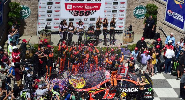 SONOMA, CALIFORNIA - JUNE 23: Martin Truex Jr., driver of the #19 Bass Pro Shops Toyota, celebrates in Victory Lane after winning the Monster Energy NASCAR Cup Series Toyota/Save Mart 350 at Sonoma Raceway on June 23, 2019 in Sonoma, California. (Photo by Jared C. Tilton/Getty Images) | Getty Images