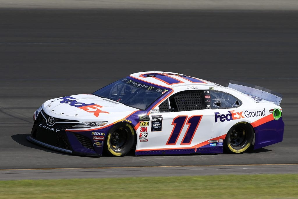 LONG POND, PENNSYLVANIA - JULY 27: Denny Hamlin, driver of the #11 FedEx Ground Toyota, qualifies for the Monster Energy NASCAR Cup Series Gander RV 400 at Pocono Raceway on July 27, 2019 in Long Pond, Pennsylvania. (Photo by Chris Trotman/Getty Images) | Getty Images