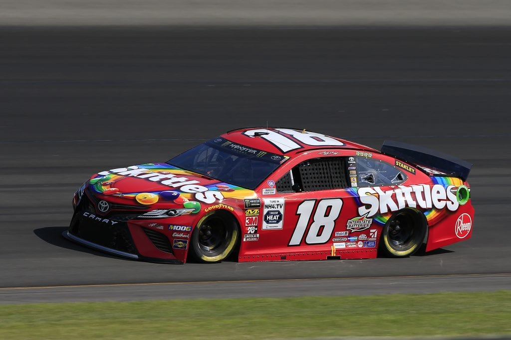LONG POND, PENNSYLVANIA - JULY 27: Kyle Busch, driver of the #18 Skittles Toyota, qualifies for the Monster Energy NASCAR Cup Series Gander RV 400 at Pocono Raceway on July 27, 2019 in Long Pond, Pennsylvania. (Photo by Chris Trotman/Getty Images) | Getty Images