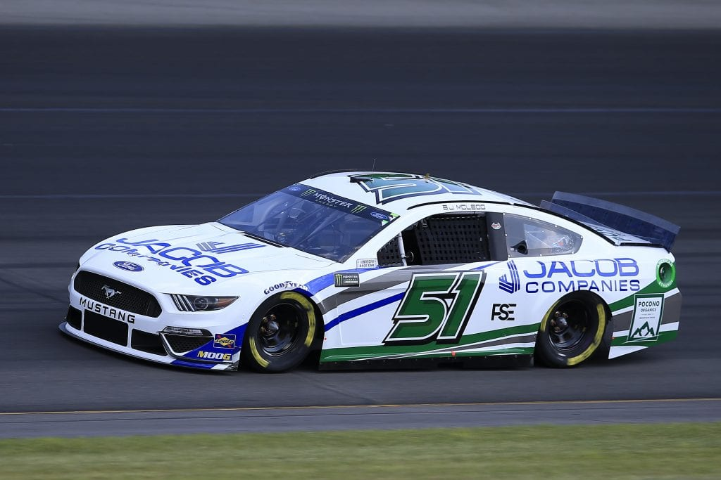 LONG POND, PENNSYLVANIA - JULY 27: BJ McLeod, driver of the #51 JACOB COMPANIES/Pocono Organics Ford, qualifies for the Monster Energy NASCAR Cup Series Gander RV 400 at Pocono Raceway on July 27, 2019 in Long Pond, Pennsylvania. (Photo by Chris Trotman/Getty Images) | Getty Images