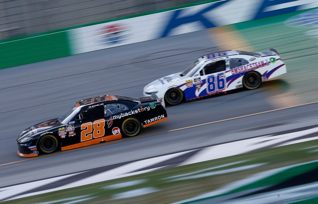 SPARTA, KENTUCKY - JULY 12: Shane Lee, driver of the #28 mybackstory.com Toyota, and Brandon Brown, driver of the #86 BMSraceTeam.com Chevrolet, race during the NASCAR Xfinity Series Alsco 300 at Kentucky Speedway on July 12, 2019 in Sparta, Kentucky. (Photo by Brian Lawdermilk/Getty Images) | Getty Images