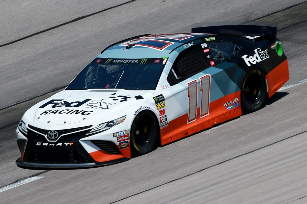 DARLINGTON, SOUTH CAROLINA - AUGUST 30: Denny Hamlin, driver of the #11 FedEx Darlington Throwback Toyota, practices for the Monster Energy NASCAR Cup Series Bojangles' Southern 500 at Darlington Raceway on August 30, 2019 in Darlington, South Carolina. (Photo by Sean Gardner/Getty Images) | Getty Images