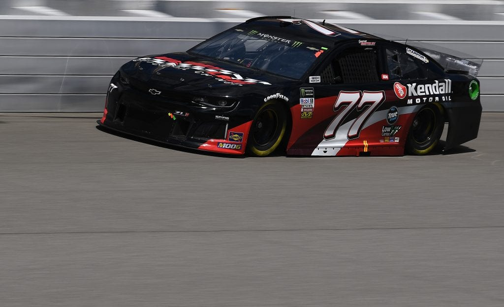 BROOKLYN, MICHIGAN - AUGUST 09: Garrett Smithley, driver of the #77 Victory Lane Quick Oil Change/Kendall Chevrolet, drives during practice for the Monster Energy NASCAR Cup Series Consumers Energy 400 at Michigan International Speedway on August 09, 2019 in Brooklyn, Michigan. (Photo by Stacy Revere/Getty Images) | Getty Images