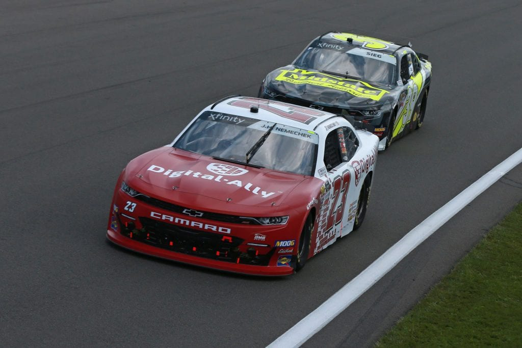 WATKINS GLEN, NEW YORK - AUGUST 03: John Hunter Nemechek, driver of the #23 Digital Ally Chevrolet, leads a pack of cars during the NASCAR Xfinity Series Zippo 200 at The Glen at Watkins Glen International on August 03, 2019 in Watkins Glen, New York. (Photo by Sean Gardner/Getty Images)   Getty Images