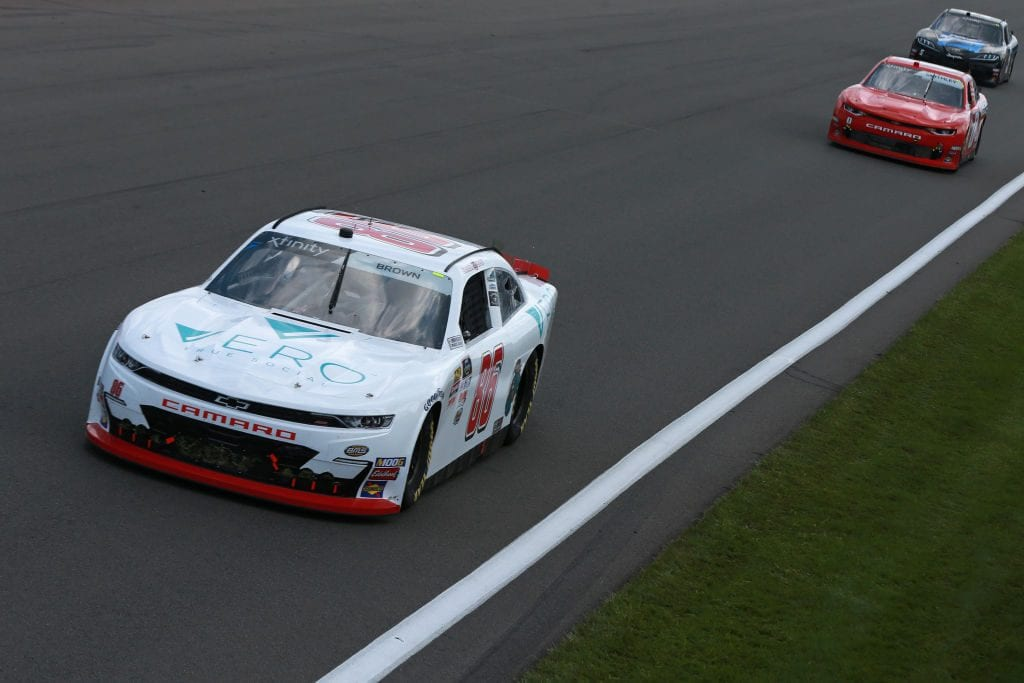 WATKINS GLEN, NEW YORK - AUGUST 03: Brandon Brown, driver of the #86 Vero Tru Social Chevrolet, leads a pack of cars during the NASCAR Xfinity Series Zippo 200 at The Glen at Watkins Glen International on August 03, 2019 in Watkins Glen, New York. (Photo by Sean Gardner/Getty Images)   Getty Images