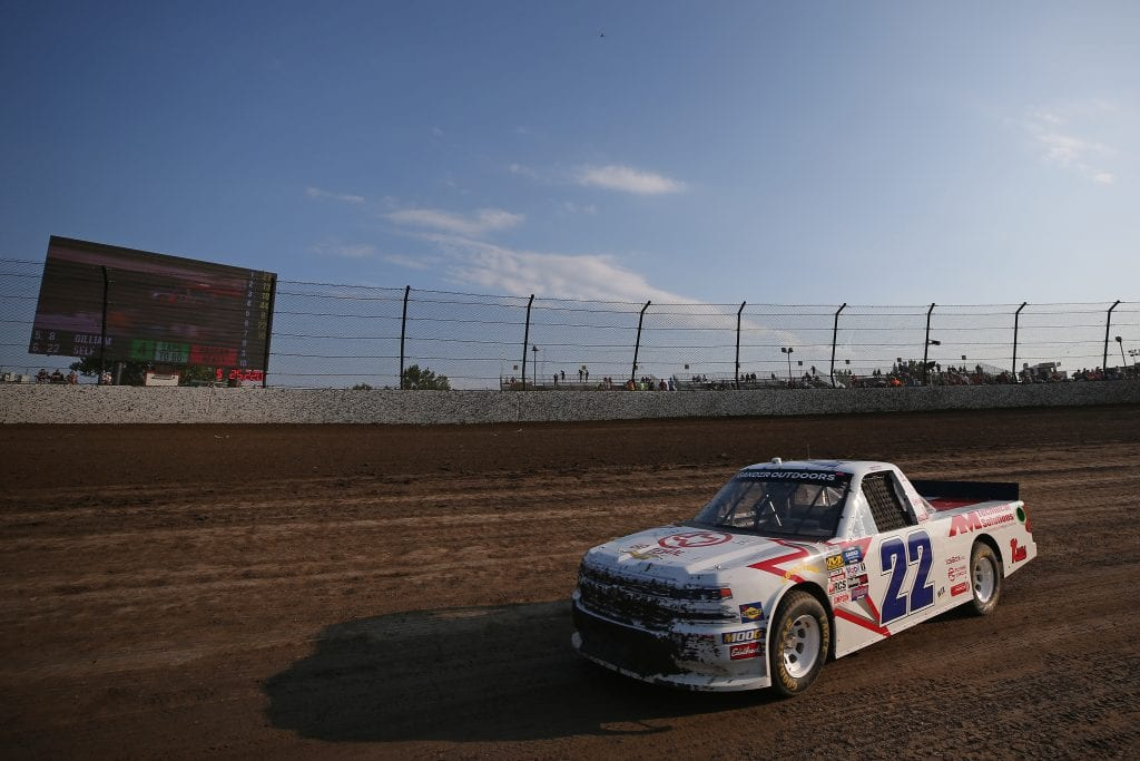 ROSSBURG, OHIO - AUGUST 01: Austin Wayne Self, driver of the #22 GO TEXAN/AM Technical Solutions Chevrolet, drives during a qualifying race for the NASCAR Gander Outdoor Truck Series Eldora Dirt Derby at Eldora Speedway on August 01, 2019 in Rossburg, Ohio. (Photo by Matt Sullivan/Getty Images) | Getty Images