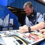 BROOKLYN, MICHIGAN - AUGUST 09: Dale Earnhardt Jr. signs autographs during practice for the Monster Energy NASCAR Cup Series Consumers Energy 400 at Michigan International Speedway on August 09, 2019 in Brooklyn, Michigan. (Photo by Stacy Revere/Getty Images) | Getty Images