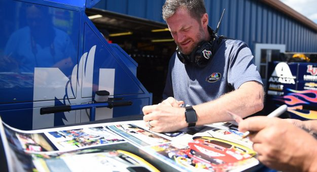 BROOKLYN, MICHIGAN - AUGUST 09: Dale Earnhardt Jr. signs autographs during practice for the Monster Energy NASCAR Cup Series Consumers Energy 400 at Michigan International Speedway on August 09, 2019 in Brooklyn, Michigan. (Photo by Stacy Revere/Getty Images)   Getty Images