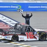 BROOKLYN, MICHIGAN - AUGUST 10: Austin Hill, driver of the #16 Hino/AISIN Group Toyota, celebrates after winning the NASCAR Gander Outdoor Truck Series Corrigan Oil 200 at Michigan International Speedway on August 10, 2019 in Brooklyn, Michigan. (Photo by Quinn Harris/Getty Images) | Getty Images