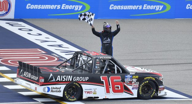 BROOKLYN, MICHIGAN - AUGUST 10: Austin Hill, driver of the #16 Hino/AISIN Group Toyota, celebrates after winning the NASCAR Gander Outdoor Truck Series Corrigan Oil 200 at Michigan International Speedway on August 10, 2019 in Brooklyn, Michigan. (Photo by Quinn Harris/Getty Images)   Getty Images