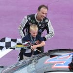 BROOKLYN, MICHIGAN - AUGUST 11: Kevin Harvick, driver of the #4 Mobil 1 Ford, helps his son Keelan into the car with the checkered flag after winning the Monster Energy NASCAR Cup Series Consumers Energy 400 at Michigan International Speedway on August 11, 2019 in Brooklyn, Michigan. (Photo by Matt Sullivan/Getty Images) | Getty Images