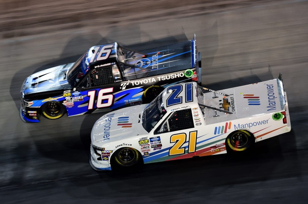BRISTOL, TENNESSEE - AUGUST 15: Sam Mayer, driver of the #21 Manpower Chevrolet, races Austin Hill, driver of the #16 Toyota Tsusho Toyota, during the NASCAR Gander Outdoor Truck Series UNOH 200 presented by Ohio Logistics at Bristol Motor Speedway on August 15, 2019 in Bristol, Tennessee. (Photo by Jared C. Tilton/Getty Images) | Getty Images