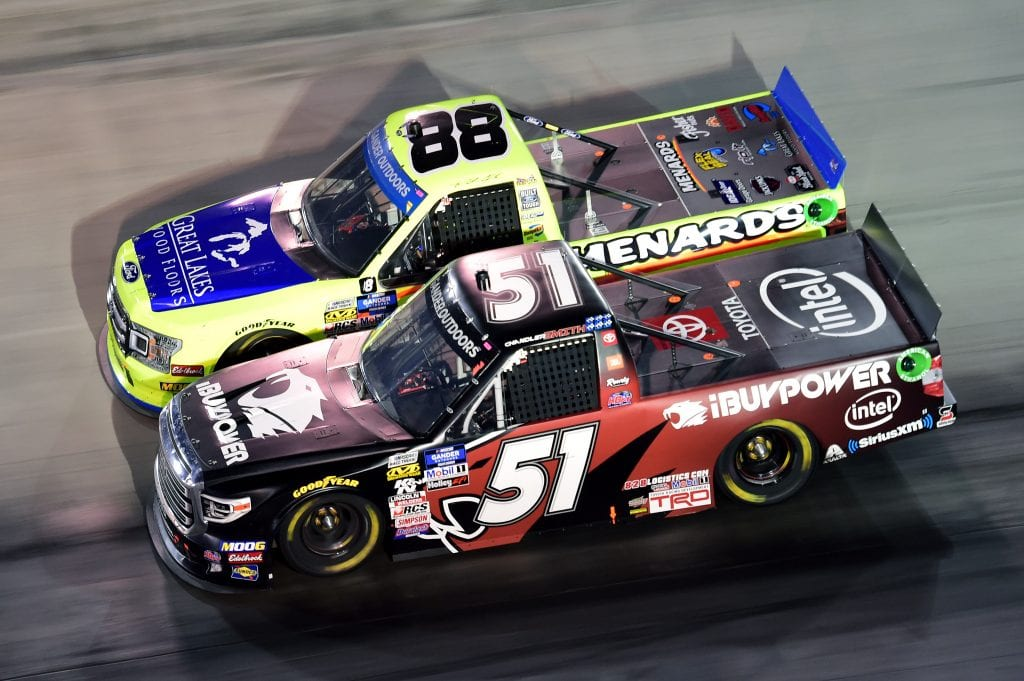 BRISTOL, TENNESSEE - AUGUST 15: Chandler Smith, driver of the #51 iBUYPOWER Toyota, races Matt Crafton, driver of the #88 Great Lakes Wood Floors/Menards Ford, during the NASCAR Gander Outdoor Truck Series UNOH 200 presented by Ohio Logistics at Bristol Motor Speedway on August 15, 2019 in Bristol, Tennessee. (Photo by Jared C. Tilton/Getty Images) | Getty Images