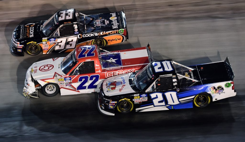 BRISTOL, TENNESSEE - AUGUST 15: Ryan Sieg, driver of the #33 Cook's Comfort System Chevrolet, Austin Wayne Self, driver of the #22 GO TEXAN Chevrolet, and Landon Huffman, driver of the #20 PitStopsForHope.org/Wrench Rags Chevrolet, race during the NASCAR Gander Outdoor Truck Series UNOH 200 presented by Ohio Logistics at Bristol Motor Speedway on August 15, 2019 in Bristol, Tennessee. (Photo by Jared C. Tilton/Getty Images) | Getty Images