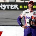 BRISTOL, TENNESSEE - AUGUST 16: Denny Hamlin, driver of the #11 FedEx Freight Toyota, stands on the grid during qualifying for the Monster Energy NASCAR Cup Series Bass Pro Shops NRA Night Race at Bristol Motor Speedway on August 16, 2019 in Bristol, Tennessee. (Photo by Sean Gardner/Getty Images) | Getty Images