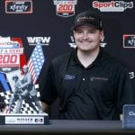 DARLINGTON, SOUTH CAROLINA - AUGUST 31: Cole Custer, driver of the #00 Production Alliance Group Ford, poses with the trophy after winning the NASCAR Xfinity Series Sport Clips Haircuts VFW 200 at Darlington Raceway on August 31, 2019 in Darlington, South Carolina. The #18 Sport Clips Toyota, driven by Denny Hamlin (not pictured), was deemed illegal after post race inspection and was stripped of the victory. (Photo by Brian Lawdermilk/Getty Images) | Getty Images