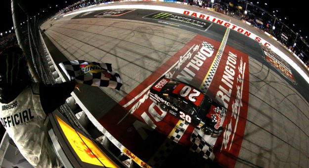 DARLINGTON, SOUTH CAROLINA - SEPTEMBER 02: Erik Jones, driver of the #20 Sport Clips Throwback Toyota, takes the checkered flag to win the Monster Energy NASCAR Cup Series Bojangles' Southern 500 at Darlington Raceway on September 02, 2019 in Darlington, South Carolina. (Photo by Sean Gardner/Getty Images)   Getty Images