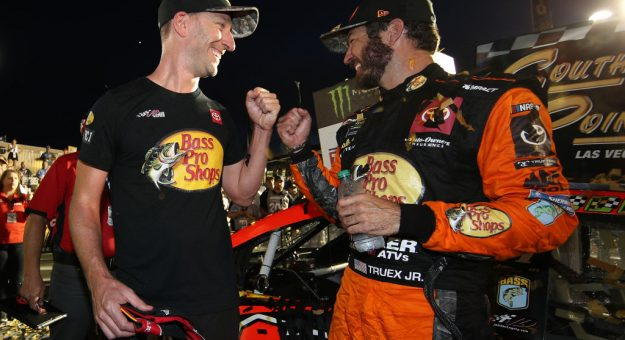 LAS VEGAS, NEVADA - SEPTEMBER 15: Martin Truex Jr., driver of the #19 Bass Pro Shops Toyota, and crew chief Cole Pearn celebrates in victory lane after winning the Monster Energy NASCAR Cup Series South Point 400 at Las Vegas Motor Speedway on September 15, 2019 in Las Vegas, Nevada. (Photo by Chris Graythen/Getty Images) | Getty Images