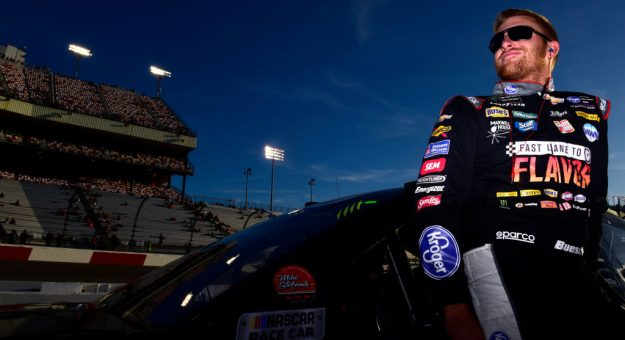 RICHMOND, VIRGINIA - SEPTEMBER 20: Chris Buescher, driver of the #37 Fast Lane to Flavor Chevrolet, stands on the grid during qualifying for the Monster Energy NASCAR Cup Series Federated Auto Parts 400 at Richmond Raceway on September 20, 2019 in Richmond, Virginia. (Photo by Jared C. Tilton/Getty Images)   Getty Images