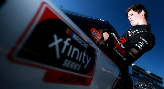 RICHMOND, VIRGINIA - SEPTEMBER 20: Harrison Burton, driver of the #18 DEX Imaging Toyota, climbs into his car during practice for the NASCAR Xfinity Series GoBowling 250 at Richmond Raceway on September 20, 2019 in Richmond, Virginia. (Photo by Sean Gardner/Getty Images) | Getty Images