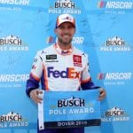 DOVER, DELAWARE - OCTOBER 05: Denny Hamlin, driver of the #11 FedEx Express Toyota, poses with the pole award after qualifying for the Monster Energy NASCAR Cup Series Drydene 400 at Dover International Speedway on October 05, 2019 in Dover, Delaware. (Photo by Matt Sullivan/Getty Images) | Getty Images