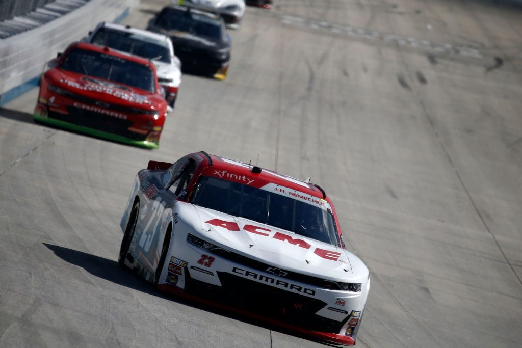DOVER, DELAWARE - OCTOBER 05: John Hunter Nemechek, driver of the #23 ACME Chevrolet, leads a pack of cars during the NASCAR Xfinity Series Use Your Melon Drive Sober 200 at Dover International Speedway on October 05, 2019 in Dover, Delaware. (Photo by Jeff Zelevansky/Getty Images)