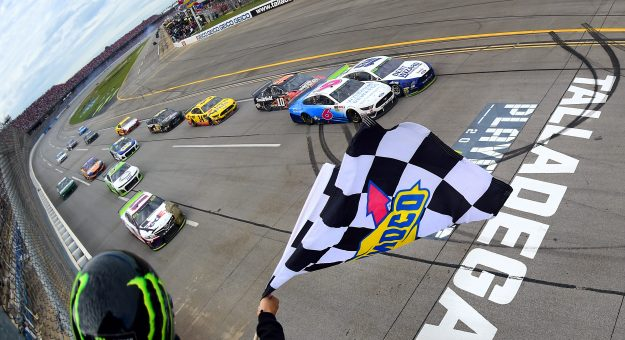TALLADEGA, ALABAMA - OCTOBER 14: Ryan Blaney, driver of the #12 Dent Wizard Ford, takes the checkered flag ahead of Ryan Newman, driver of the #6 Wyndham Rewards Ford, to win the Monster Energy NASCAR Cup Series 1000Bulbs.com 500 at Talladega Superspeedway on October 14, 2019 in Talladega, Alabama. (Photo by Jared C. Tilton/Getty Images) | Getty Images