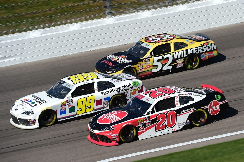 KANSAS CITY, KANSAS - OCTOBER 19: Christopher Bell, driver of the #20 Rheem Toyota, races Josh Bilicki, driver of the #99 Furniture Mall of Kansas Toyota, and David Starr, driver of the #52 Wilkerson Rental Chevrolet, during the NASCAR Xfinity Series Kansas Lottery 300 at Kansas Speedway on October 19, 2019 in Kansas City, Kansas. (Photo by Jared C. Tilton/Getty Images) | Getty Images