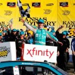 KANSAS CITY, KANSAS - OCTOBER 19: Brandon Jones, driver of the #19 Flow Toyota, celebrates in victory lane after winning the NASCAR Xfinity Series Kansas Lottery 300 at Kansas Speedway on October 19, 2019 in Kansas City, Kansas. (Photo by Jonathan Ferrey/Getty Images) | Getty Images
