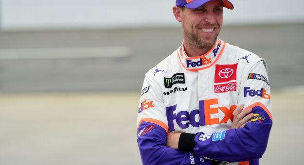 MARTINSVILLE, VIRGINIA - OCTOBER 26: Denny Hamlin, driver of the #11 FedEx Freight Toyota, stands on the grid during qualifying for the Monster Energy NASCAR Cup Series First Data 500 at Martinsville Speedway on October 26, 2019 in Martinsville, Virginia. (Photo by Jared C. Tilton/Getty Images)   Getty Images