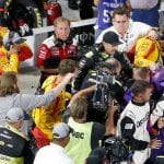 MARTINSVILLE, VIRGINIA - OCTOBER 27: Denny Hamlin, driver of the #11 FedEx Freight Toyota, Joey Logano, driver of the #22 Shell Pennzoil Ford, and their crews have an altercation on pit lane following the Monster Energy NASCAR Cup Series First Data 500 at Martinsville Speedway on October 27, 2019 in Martinsville, Virginia. (Photo by Brian Lawdermilk/Getty Images) | Getty Images