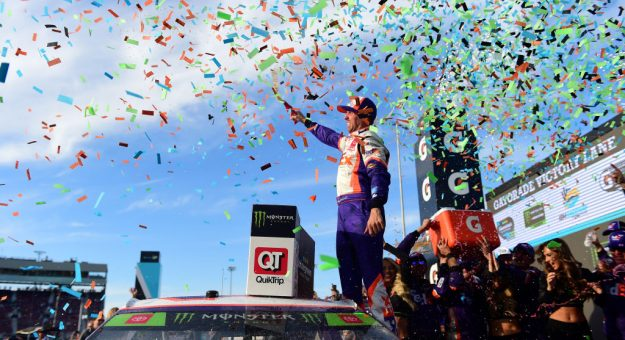 AVONDALE, ARIZONA - NOVEMBER 10: Denny Hamlin, driver of the #11 FedEx Ground Toyota, celebrates in Victory Lane after winning the Monster Energy NASCAR Cup Series Bluegreen Vacations 500 at ISM Raceway on November 10, 2019 in Avondale, Arizona. (Photo by Jared C. Tilton/Getty Images) | Getty Images