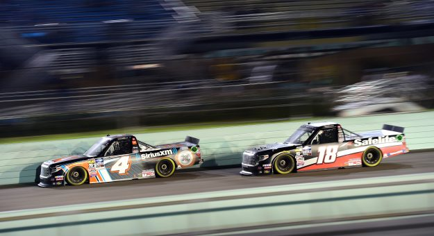 HOMESTEAD, FLORIDA - NOVEMBER 15: Todd Gilliland, driver of the #4 JBL/SiriusXM Toyota, leads Harrison Burton, driver of the #18 Safelite AutoGlass Toyota, during the NASCAR Gander Outdoors Truck Series Ford EcoBoost 200 at Homestead-Miami Speedway on November 15, 2019 in Homestead, Florida. (Photo by Jared C. Tilton/Getty Images)   Getty Images