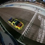 HOMESTEAD, FLORIDA - NOVEMBER 15: Matt Crafton, driver of the #88 Jack Links/Menards Ford, takes the checkered flag to win the NASCAR Gander Outdoors Truck Series Ford EcoBoost 200 at Homestead-Miami Speedway on November 15, 2019 in Homestead, Florida. (Photo by Sean Gardner/Getty Images) | Getty Images