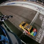 HOMESTEAD, FLORIDA - NOVEMBER 17: Kyle Busch, driver of the #18 M&M's Toyota, takes the checkered flag to win the Monster Energy NASCAR Cup Series Championship and the Monster Energy NASCAR Cup Series Ford EcoBoost 400 at Homestead Speedway on November 17, 2019 in Homestead, Florida. (Photo by Sean Gardner/Getty Images) | Getty Images
